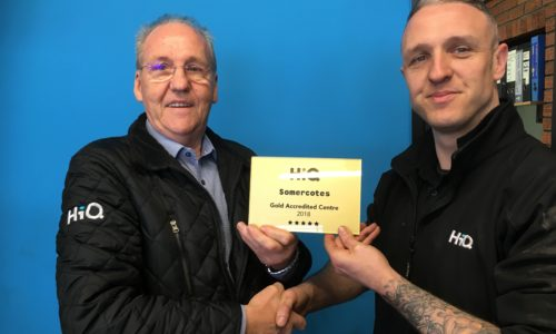HiQ Somercotes- Shaun Doyle receiving their Gold Standard Award 2018