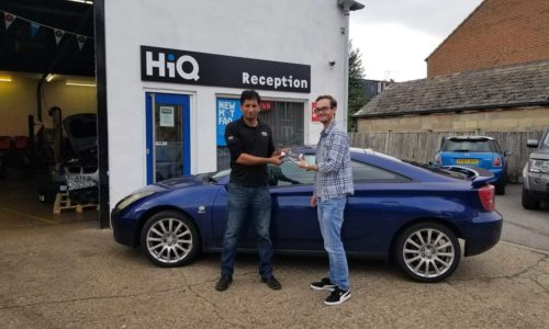 HiQ Oxford customer collecting Pizza Express vouchers from manager Zaheer Iqbal- Summer Nights promotion