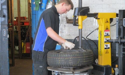 HiQ Burton Eoin working on a tyre