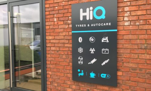 Exterior signage showing main services and facilities at HiQ Enfield